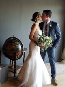 A modern bride & groom sharing a kiss at their wedding. SoundFire DJ is all about creating these memories with you.